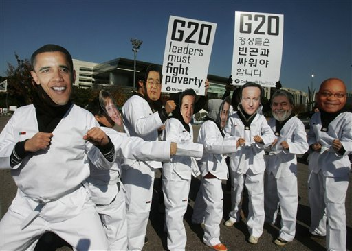 Activists of Oxfam International don masks of the world leaders, including U.S. President Barack Obama, far left, and pose in Tae Kwon Do costumes during a demonstration to draw attention to global poverty issues one day before the G-20 summit in Seoul, South Korea, Wednesday, Nov. 10, 2010.